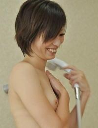 Svelte asian MILF Chiaki Sugai takes shower and gives a soapy handjob
