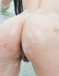 Foxy honey with fat jugs Lana B taking off her bikini in the bath