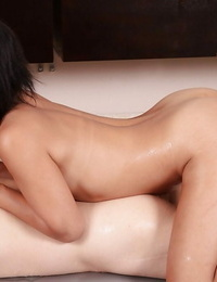 Sugary asian masseuse performs an oily arm and blowjob
