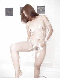 Bangable asian stunner taking shower and rubbing her soapy forms