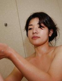 Brown-haired milf Yuko Goto reveals her Asian vagina while taking tub