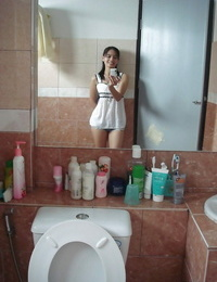 Petite Thai girl tales self shots before unclothing bare in bathroom