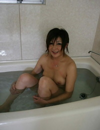 Keiko Ayata taking a molten bath and displaying her forms on camera