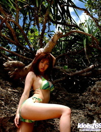 Buxomy asian stunner Adusa Kyono slipping off her bathing suit outdoor