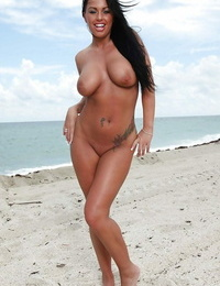 Asian babe Asa Akira and Kerry Louise position together on the beach