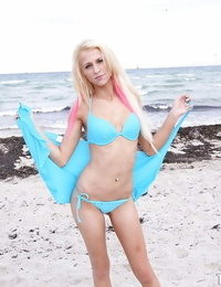 Handsome blonde Cassy Lynn sliding off her bathing suit top outdoor