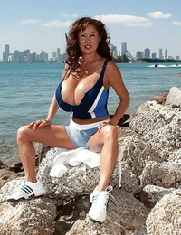 Bigtitted asian mature takes her immense knockers for a walk around the city