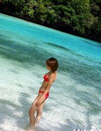 Beautiful asian babe Minami Aikawa posing in underwear outdoor