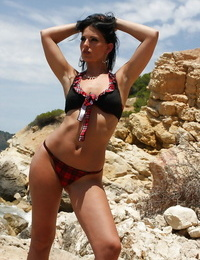 Adult movie star stunner Mili Jay peels off off skirt and underwear for erotic posing