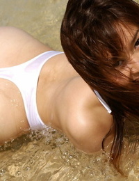 Pretty asian stunner Adusa Kyono uncovering her tempting kinks outdoor
