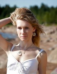 Classy slender honey Mariana walks on the beach and does naked shoots