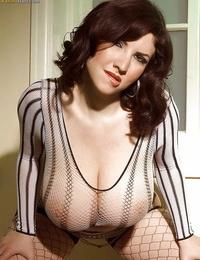 Plump European MILF Karina Hart unleashing giant tits from mesh half-shirt