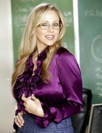 Provocative blond teacher in glasses Julia Ann undressing in the class