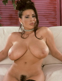 Scorching Mummy Linsey Dawn McKenzie releases her tits as she takes off to pantyhose