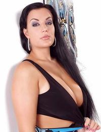 Brunette solo model Carmen loosing fat hooters on way to posing bare