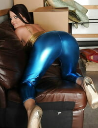 Beauteous Mummy Sophie Dee disrobing her ass from latex leggings