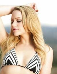 Blonde honey Mia Malkova posing solo outdoors in a bathing suit