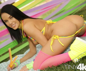 Young solo chick Megan Rain ditches her bikini wearing rosy over the knee socks