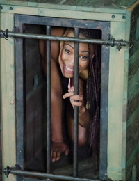 Naked female is confined and abased before compelled masturbation