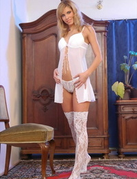 Blond chick Marcy flaunts her brilliant ass in over the knee hosiery