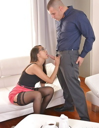 Glasses clothed Asian Sharon Lee providing older white dude a blowjob