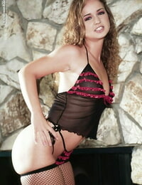 Foxy honey with meaty pouch Luissa Rosso taking off her undergarments