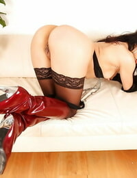 Fuckable brown-haired in crimson boots revealing her titties and shaved pussy