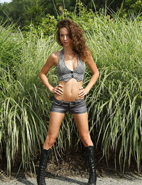 Ravishing amateur stunner in boots stripping and playing her slit outdoor