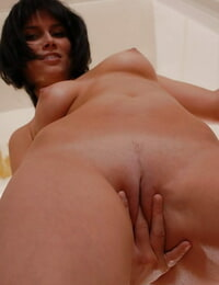 Brown-haired lady next door Diane slides peach colored undies over her naked nuts