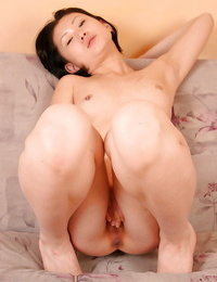 Diminutive Asian amateur Dia toying with small boobs and trimmed twat