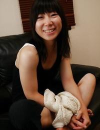 Asian housewife Aiko Kurita stretching her fur covered Oriental vagina