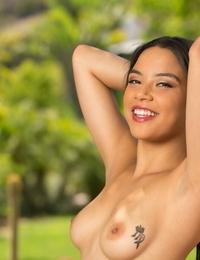 Smiling Latina lady Maya Bijou takes off clothes outdoors to display her nakedness