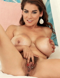 Huge boobed lady Mischel Lee uncovers her pierced beaver as she unwraps