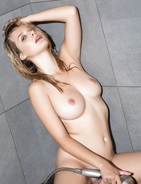 Centerfold blonde with fat all natural breasts gets wet in shower