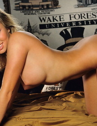 Smiling blonde beauty Madison Maynes peels off her clothes for Playboy