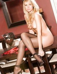 Sexy blonde babe in stockings Bernadette Adkins disrobing off her underwear