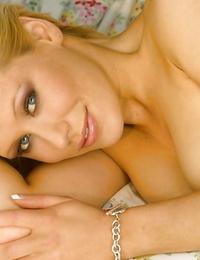 Pretty ash-blonde honey Mia Valentine gliding off her trendy undergarments
