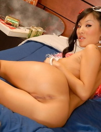 Asian girl Asa Akira peels off off her cheerleader skirt to spread vagina