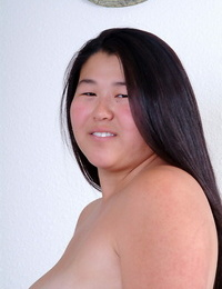 Lush Asian very first timer baring diminutive knockers while shedding cheer uniform