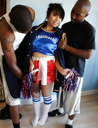 Amazing asian cheerleader May gets banged by these two seized cocks