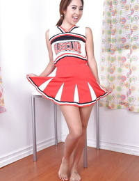 Youthful Asian amateur Mila Jade unveiling lil\' boobs melon cheerleader outfit