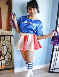Puny Oriental cheerleader May Lee flashing black subjugation under mini-skirt