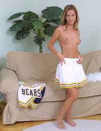 Naughty ash-blonde cheerleader getting naked and exposing her groin
