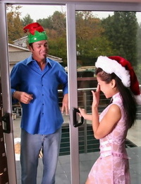Allegiance dressed Asian slobber-filled with crossed gams entertains dude at Christmas time