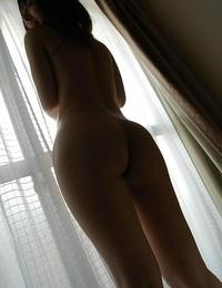 Asian babe Risa Yamane posing bare and displaying her pink twat in close up