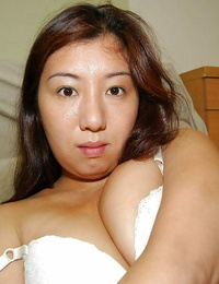 Bashful asian lady strips down and has some cunt fingerblasting fun