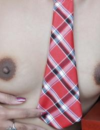 Asian schoolgirl Akira hikes miniskirt for adorable upskirt of hairy cunt