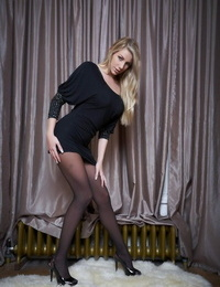 Beautiful blonde chick Danielle Maye rolls off her tights on a suffer skin