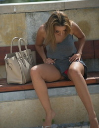 Sexy female Rebecca Kelly peels off to her red thong out in public