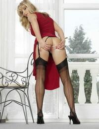 Sexy light-haired model Sweet Denisa in black rosebutt posing topless on a stool